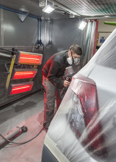 Vehicle spray painting - during